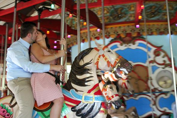 NYCCentralParkEngagementPhotos.carouselkiss.apicturesquememoryphotography