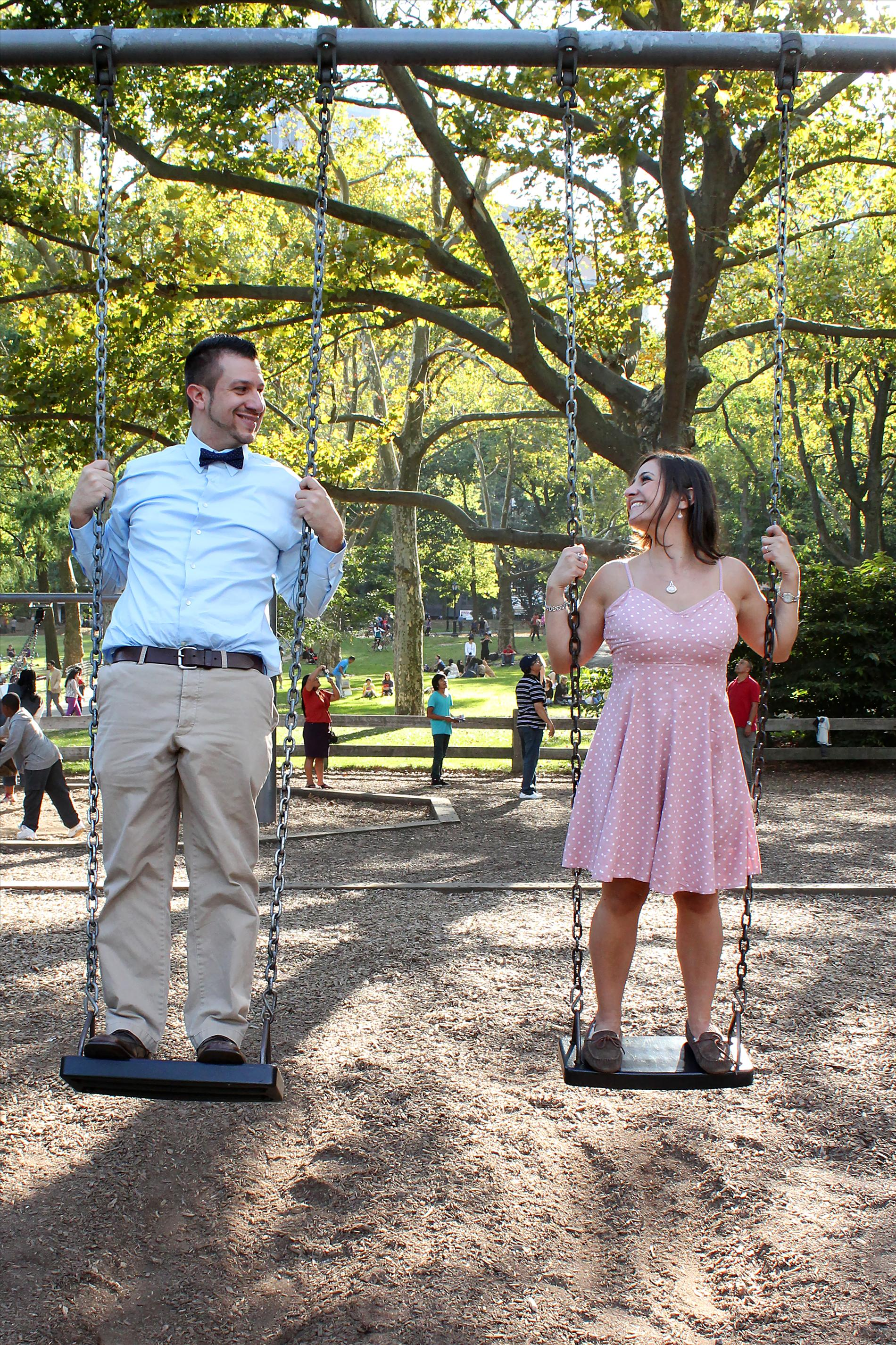 NYCCentralParkEngagementPhotos.standingonplaygroundswings.apicturesquememoryphotography