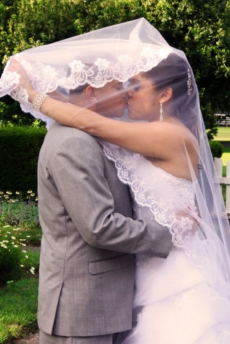 60-bride_kissing_groom-veil_over_face_kiss