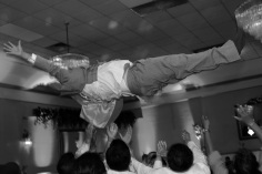 wedding-photos.wedding-photographer.groom-tossed-in-air.a-picturesque-memory-photography