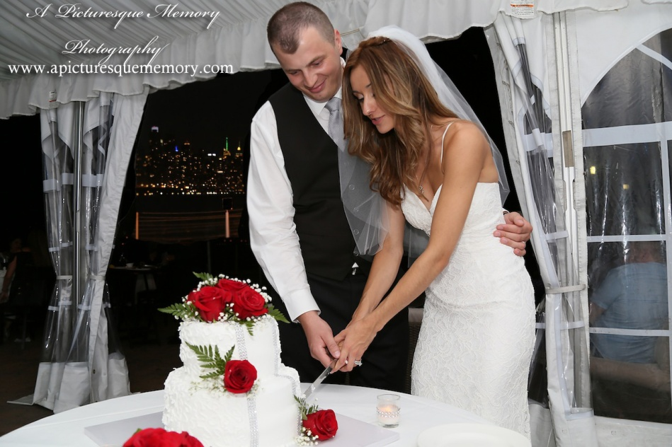 #brideandgroom, #justmarried, #njwedding, #apicturesquememoryphotography, #weddingphotography, #weddings, #weddingcake, #watersiderestaurant, #cakecutting