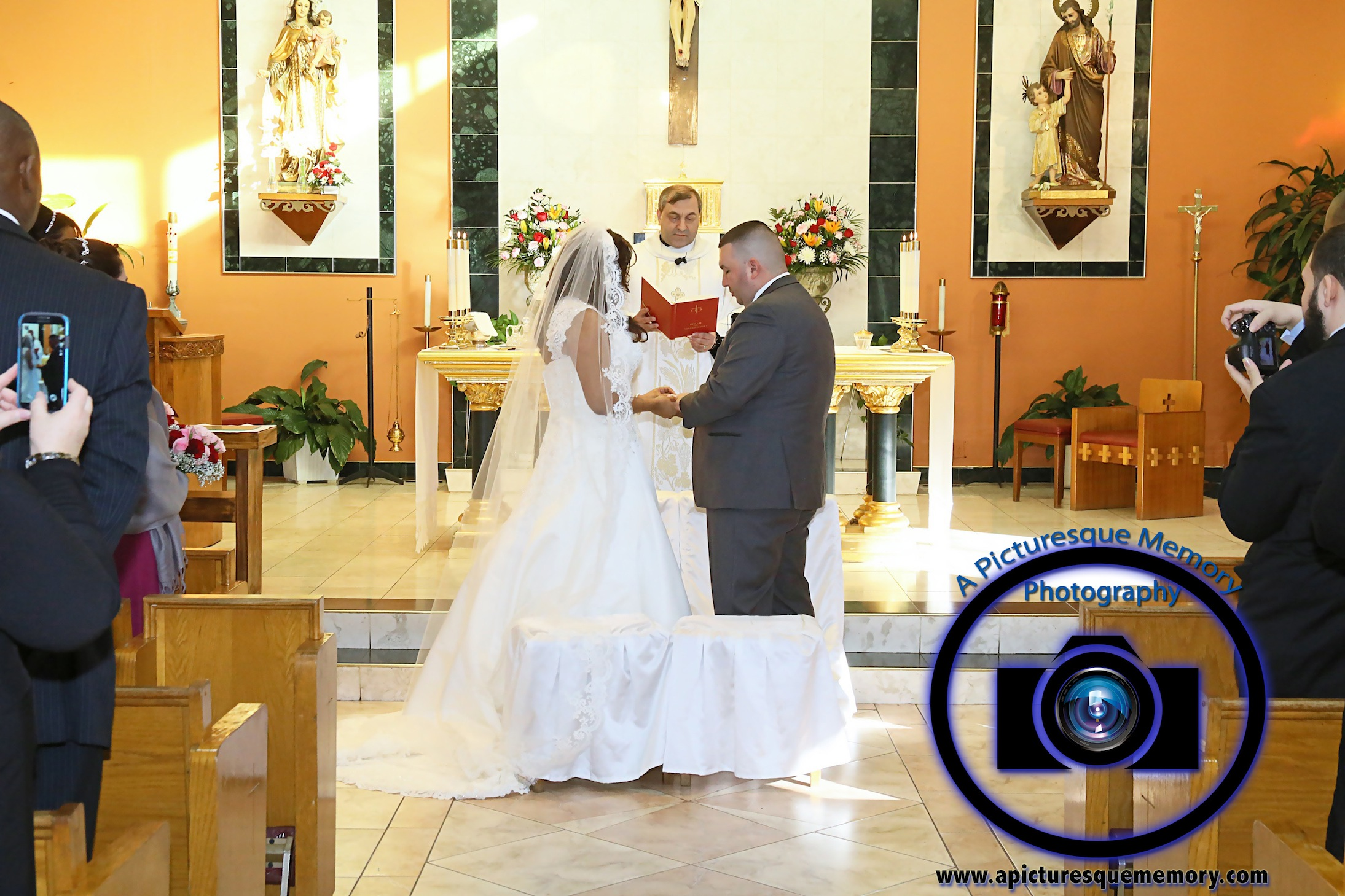 #njwedding, #njweddingphotography, #newbrunswickweddingphotographer#weddingphotos, #apicturesquememoryphotography, #ourladyofmountcarmelweddingphotographer, #weddingceremony, #brideandgroom, #ringexchange