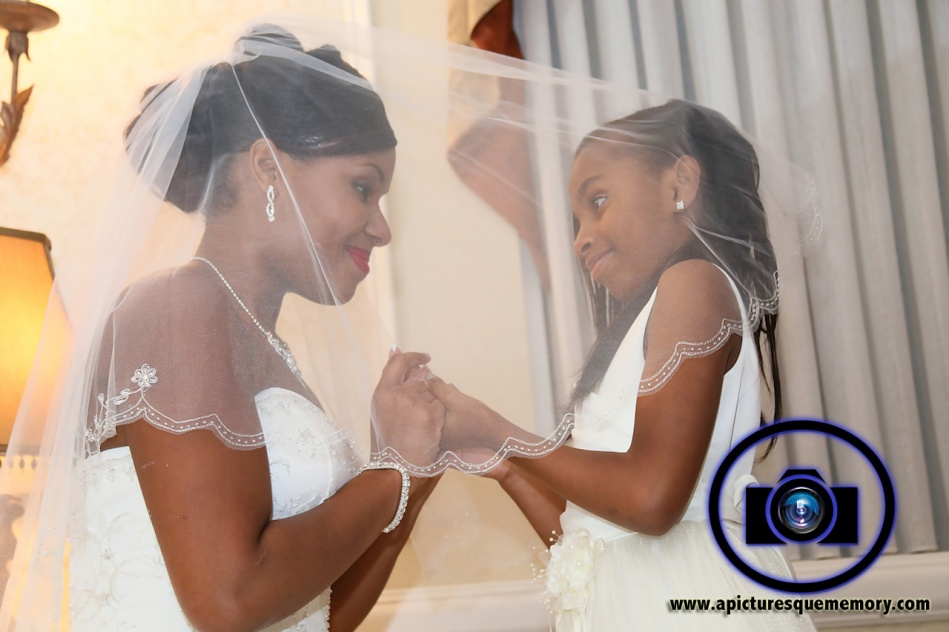 bride with flowergirl at bridgewater manor wedding photos by NJ wedding photographer apicturesquememoryphotography