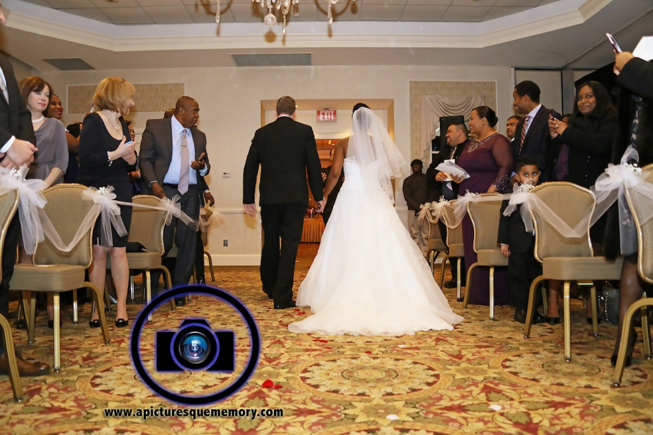 bride and groom aisle at bridgewater manor wedding photos by NJ wedding photographer apicturesquememoryphotography