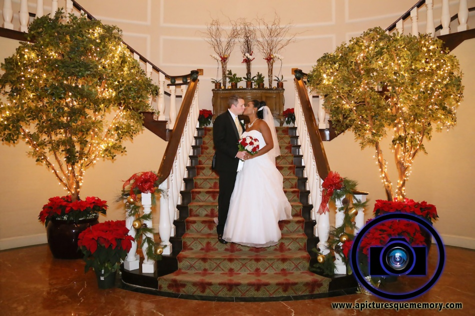 kissing on stairs at bridgewater manor wedding photos by NJ wedding photographer apicturesquememoryphotography